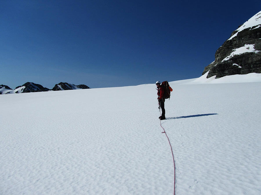 Matthew Dickinson and blue skies on a quick explore in the direction of Snowy Peak (2376m).