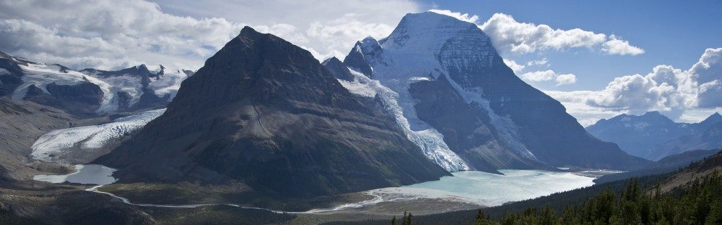 Berg Lake and Glacier rolling off the top of Mt Robson.  The race trail followed the right hand side of the lake in the forest.  Photo: facebook.com/mountrobsonmarathon